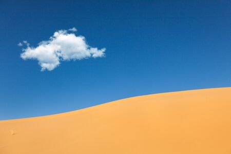 Desert  Sand dunes with white cloud in blue sky