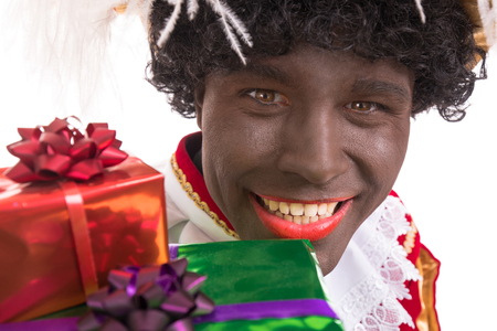 Happy Zwarte Piet or Black Pete with gifts.