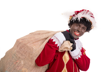 Zwarte Piet or Black Pete with burlap sack full with gifts .