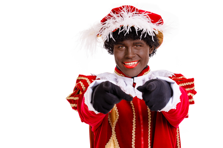 Happy Zwarte Piet or Black Pete pointing with finger towards viewer