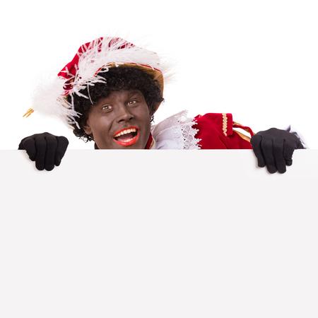 Zwarte Piet of Zwarte Piet met karton. Typisch Nederlands karakter en onderdeel van een traditioneel evenement ter ere van de verjaardag van Sinterklaas in december. Stockfoto