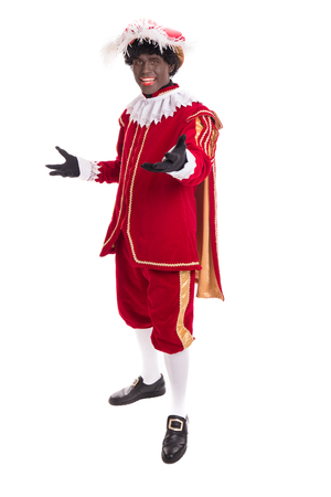 Zwarte Piet or Black Pete full length portrait. Typical Dutch character and part of a traditional event celebrating the birthday of Sinterklaas in December. Stockfoto