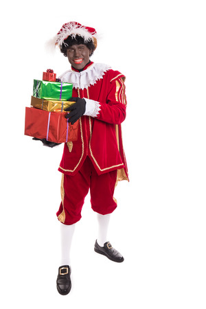 Zwarte Piet or Black Pete holding gifts. full length portrait.  Stockfoto