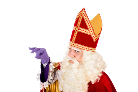Saint Nicholas holding something in his hand with space for attribute isolated on white background. Dutch character of St. Nicholas