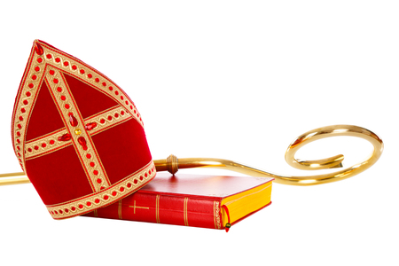 Mitre or miter book and staff of saint nicholas. Isolated on white backgroud. Part of a dutch santa tradition
