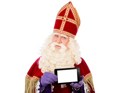 Saint Nicholas with smart phone or tablet. Isolated on white background