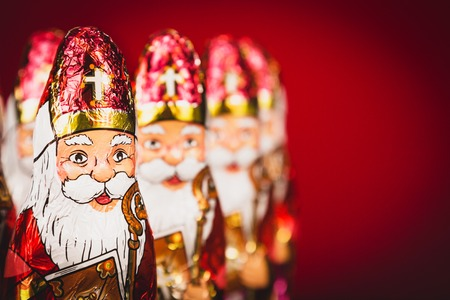 Close up of Sinterklaas figurines. Saint Nicholas chocolate figures of Dutch character of Santa Claus.with copy-space