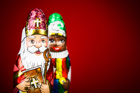 Saint Nicholas and black pete. Saint Nicholas chocolate figures of Dutch character of Santa Claus. Symbolic for black pete discussion