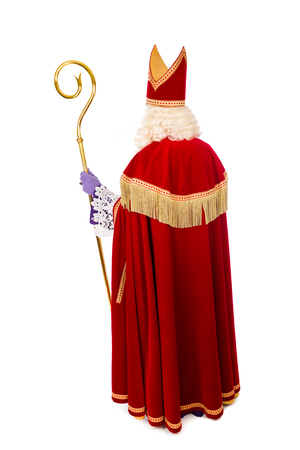 Saint Nicholas with staff portrait from behind . Full length isolated on white background