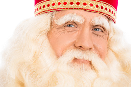 Portrait of a smiling Santa Claus on white background and looking at the camera.