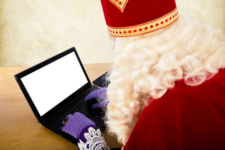 Sinterklaas with notebook. Dutch character of Santa Claus Stockfoto