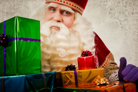 sinterklaas with gifts. Vintage Saint Nicholas in retro style with gifts. Dutch Santa Claus 免版税图像 - 110453838