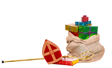 Mitre or miter sack with gifts and staff of saint nicholas. Isolated on white background.