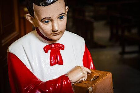 altar boy collecting money in a box for catholic church. conceptual image 스톡 콘텐츠