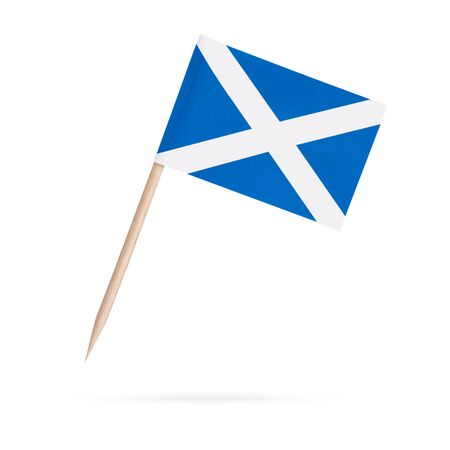 Miniature paper flag Scotland. Isolated Scottish toothpick flag pointer on white background. With shadow below 스톡 콘텐츠