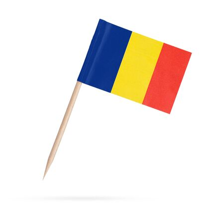 Miniature paper flag Romania. Isolated Romanian toothpick flag pointer on white background. With shadow below
