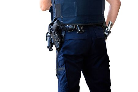 Police officer, with gun belt, handcuffs phone and pepper-spray. Isolated on white background
