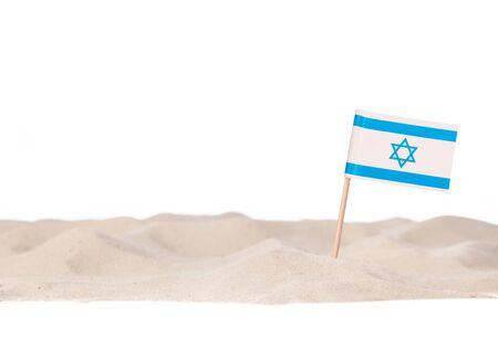 Israel Toothpick paper Flag on white beach sand. Isolated on a white background 스톡 콘텐츠