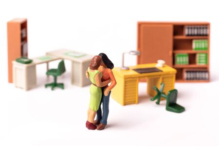 Miniature Lesbian Couple, Love at the office.Two tiny Toy Women Kissing, Concept Homosexual Relationship. 스톡 콘텐츠