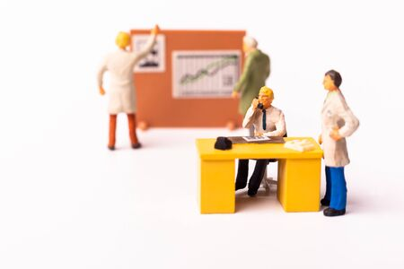 Miniature businesspeople team at the office. Macro shot of Tiny people business concept. Shallow Dept Of Field