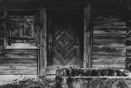 Beautiful Old Wooden wall of an abandoned house with cistern. Texture with nice pattern of wood. Personal editing with matte effect
