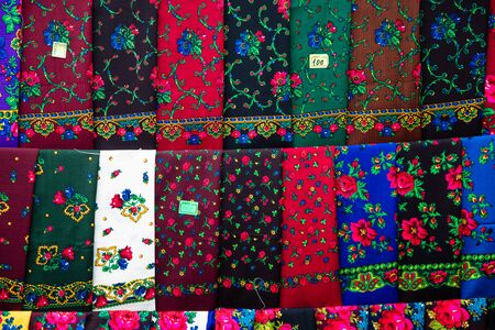Colorful Scarfs from Maramures Bucovina region Romania exposed on a market. Tags added. 스톡 콘텐츠