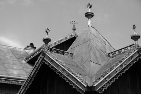 Decorated metal roof. Tin roof with ornaments. Traditional house in Maramures Romania