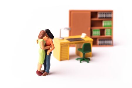 Miniature Lesbian Female Gay Couple, Two tiny Women Kissing Each other, Concept of Homosexual Relationship.