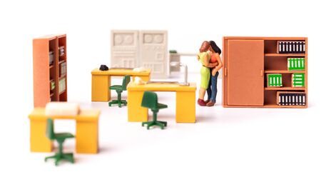 Miniature Lesbian Female Gay Couple, Two tiny People Women Kissing Each other at the office, Concept of Homosexual Relationship.