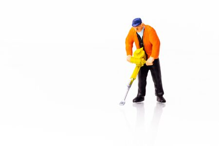 Little People Builder worker with pneumatic hammer drill equipment on white background with reflection