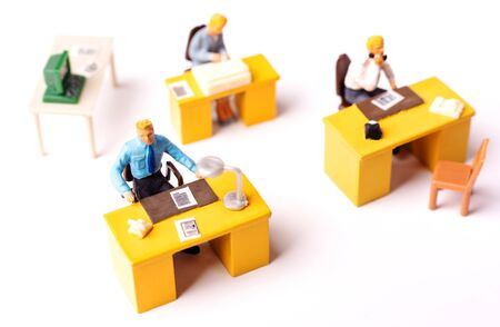 Miniature business people team at the office. Macro shot of Tiny people business concept. Shallow Dept Of Field