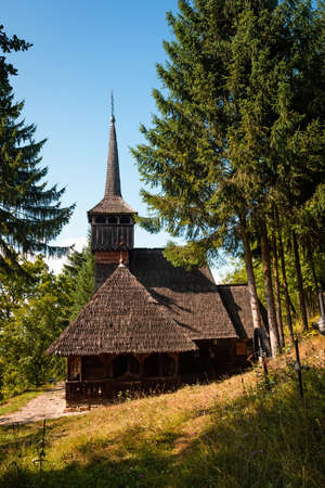 Exterior of Representative wooden church in Maramures Romania from Desesti, built in 1770 and listed by Unesco as World Heritage Site Foto de archivo - 150042353