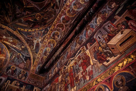 Gura Humorului, Romania - August 14, 2019: Frescoes on interior of Humor Monastery located in Gura Humorului, Romania, is one of the first of Moldova's painted monasteries. Foto de archivo - 150042355