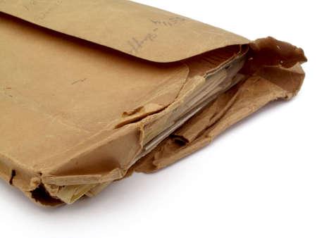 old envelope: Aged overstuffed envelope
