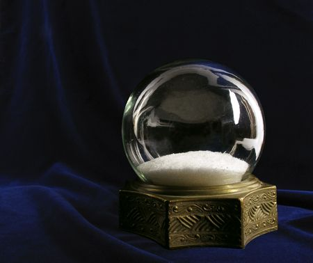 Beautiful vintage snowglobe on deep blue velvet