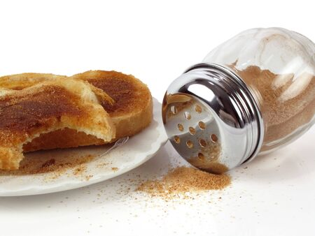 Fresh  cinnamon toast with cinnamon dispenser on a white background