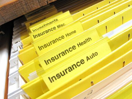 Open file cabinet showing insurance files