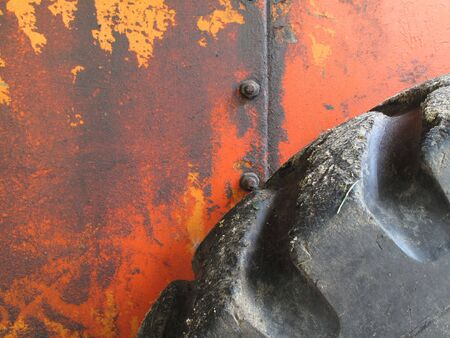 oxidized: Colorful photo of grungy old farm equiment with tire                                Stock Photo
