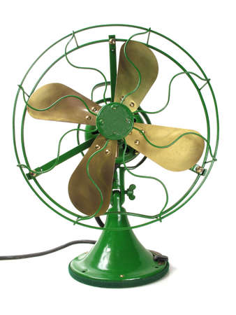 Faithfully restored antique electric brass fan in green                                 Stock Photo