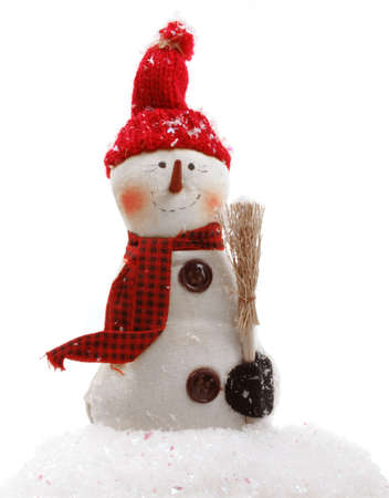 Chilly little snowman with a carrot nose is all bundled up Stock Photo - 8092502