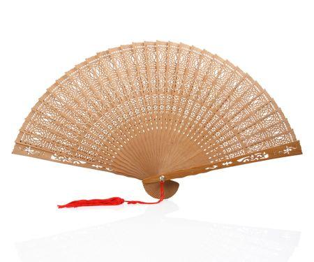 Carved wooden opera or hand fan with red tassle Reklamní fotografie - 8092529