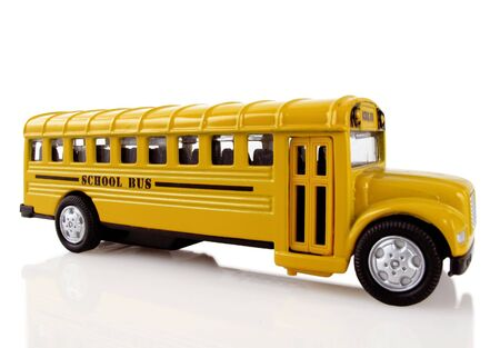 Bright yellow school bus arrives to transport children                                Stock Photo