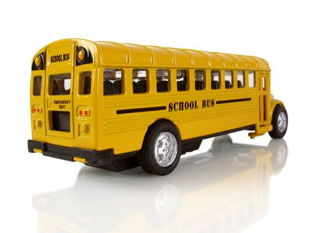 Big yellow school bus on a white reflective background                                Stock Photo