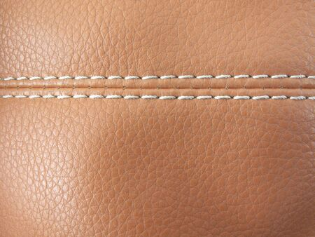 Close up detail of old leather with white stitching
