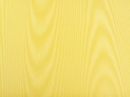 아름 다운 노란 실크 모아레 직물의 폐쇄