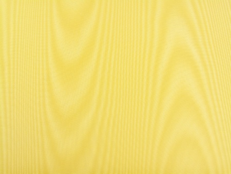 Beautiful close up of yellow silk moire fabric
