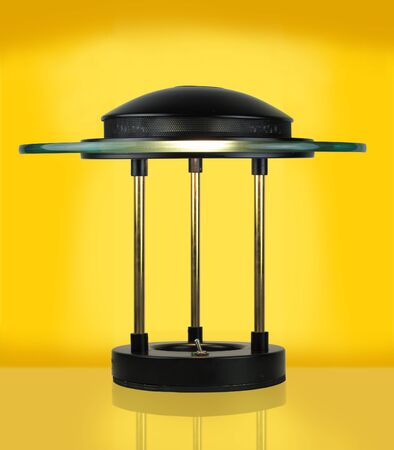 Modern Halogen Desk Lamp on yellow background