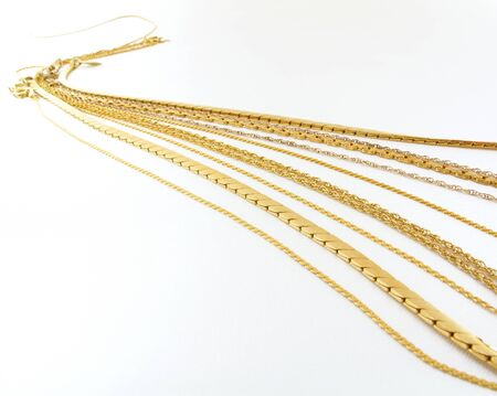 Beautiful gold necklace chains on a white background                                Stok Fotoğraf