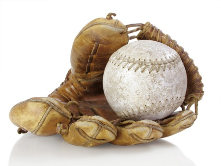 catcher's mitt: Well-used catchers mitt with tattered softball