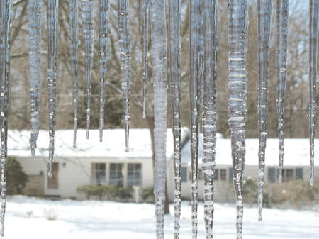 ice dam: Icicles hang from the eaves on a cold winter morning